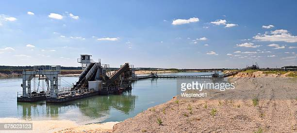 Mining of sand and gravel with a dredge