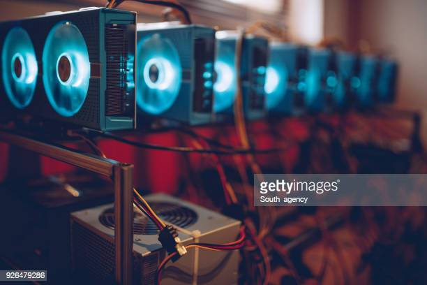 mining rig glowing - cryptocurrency mining stock photos and pictures