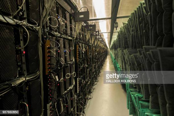 TOPSHOT Mining rigs of a super computer and air filters are pictured inside the bitcoin factory 'Genesis Farming' near Reykjavik on March 16 2018 At...