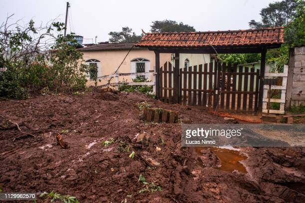 Mining tailings in the entrance of a house in Brumadinho.