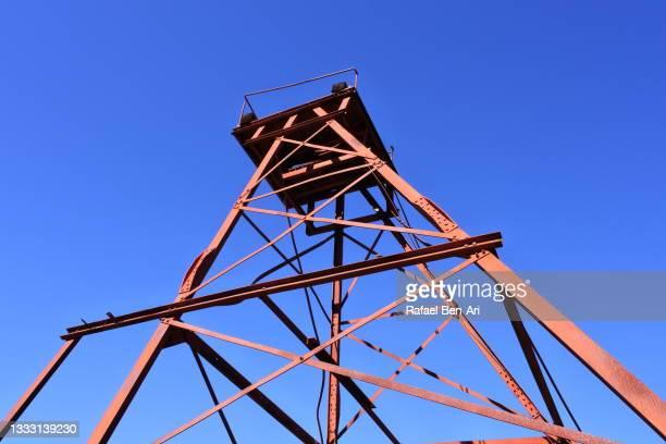 mining tower against clear blue sky - rafael ben ari fotografías e imágenes de stock