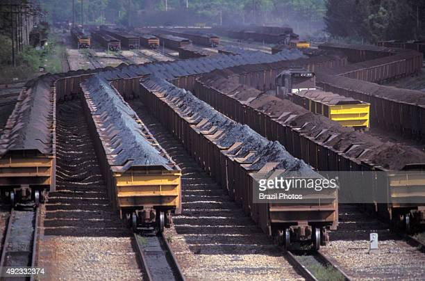 Mining transportation of iron ore for exportation in railway wagons at Tubarao Harbour in Vitoria city Espirito Santo State Brazil