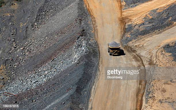 A mining truck carries diamondbearing kimberlite rock to a processing facility after being cut from the base of the Jwaneng mine operated by the...