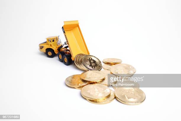 Mining Truck Dumping a Pile of Bitcoin Coins