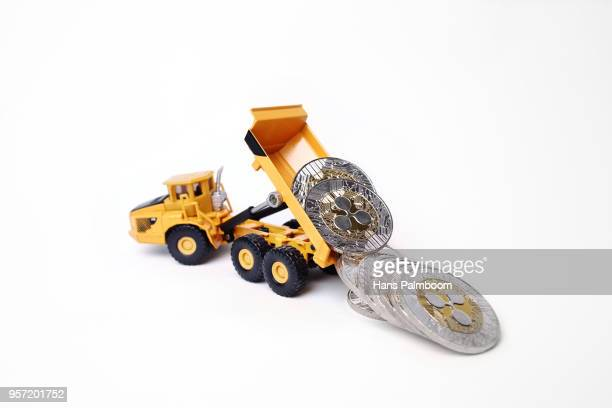 Mining Truck Dumping a Pile of Ripple XRP Coins