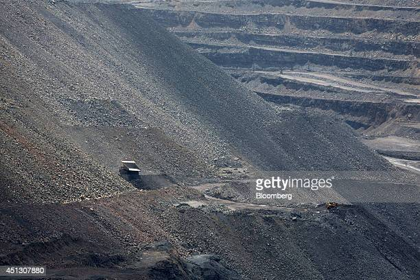 A mining truck dumps surplus rock from excavations onto the wall of the open pit during operations at the Neryungrinsky mine operated by OAO Mechel...