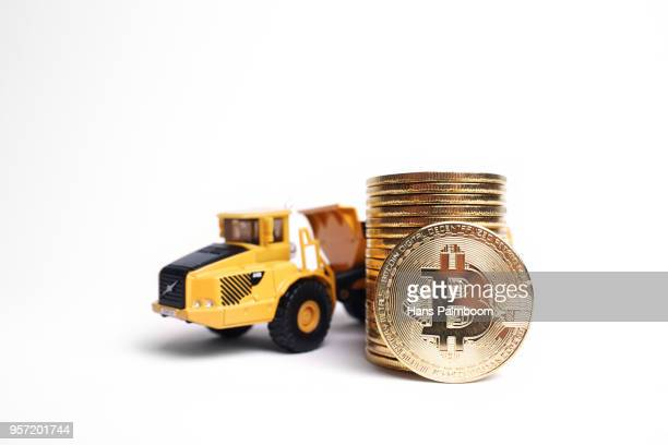 Mining Truck Next To A Stack Of Bitcoins
