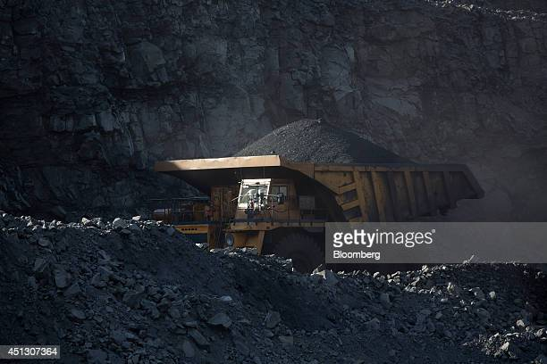 A mining truck transports coking coal away from the open pit during mining operations at the Neryungrinsky mine operated by OAO Mechel in Neryungri...