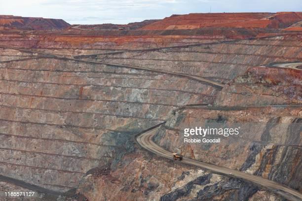 mining trucks working in the super pit open cut gold mine - kalgoorlie, western australia - 鉱山 ストックフォトと画像