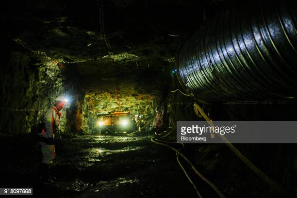 A mining vehicle illuminates a tunnel inside the Northam Platinum Ltd Booysendal platinum mine located outside the town of Lydenburg in Mpumalanga...