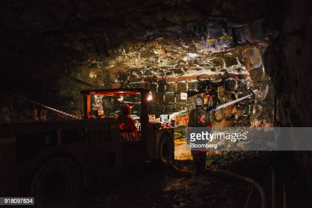 A mining vehicle illuminates the rock face inside the Northam Platinum Ltd Booysendal platinum mine located outside the town of Lydenburg in...