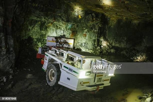 A mining vehicle illuminates the rock face the Northam Platinum Ltd Booysendal platinum mine located outside the town of Lydenburg in Mpumalanga...