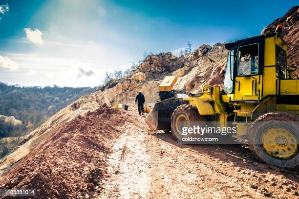 mining worker working outdoors at the quarry - detonator imagens e fotografias de stock