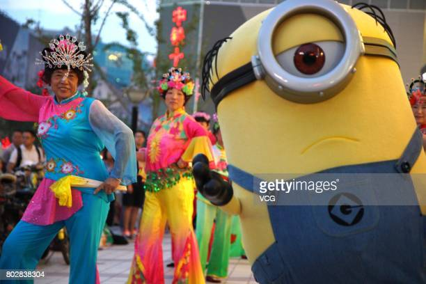 Minions dances with people at Wangfujing Street on June 20 2017 in Beijing China The Minions joined in a square dancing team in the evening on June...