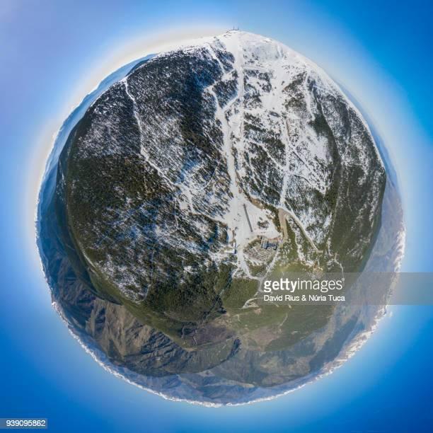 miniplanet of snowy landscape in vall fosca - weitwinkel stock-fotos und bilder