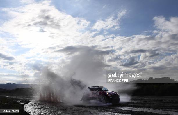 Mini's driver Boris Garafulic of Chile and codriver Portuguese Filipe Palmeiro compete during the Stage 12 of the 2018 Dakar Rally between Chilecito...