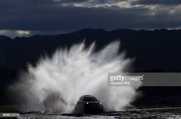 TOPSHOT Mini's driver Boris Garafulic of Chile and codriver Portuguese Filipe Palmeiro compete during the Stage 12 of the 2018 Dakar Rally between...