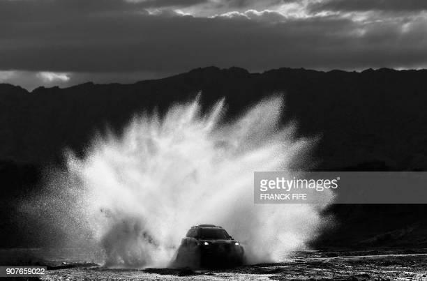 Mini's driver Boris Garafulic of Chile and codriver Portuguese Filipe Palmeiro compete during the Stage 12 of the 2018 Dakar Rally between Chilecito...