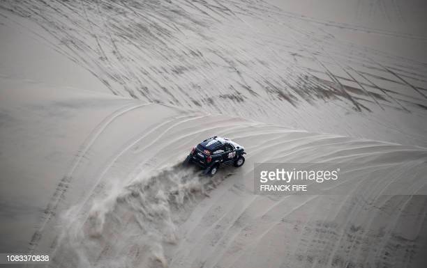Mini's driver Nani Roma of Spain and co-driver Alexandre Haro Bravo of Spain compete during the Stage 9 of the Dakar 2019 in and around Pisco, Peru,...