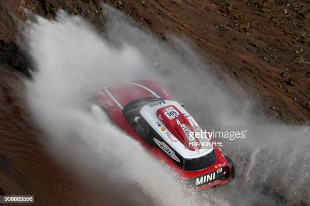 TOPSHOT Mini's Finnish driver Mikko Hirvonen and German codriver Andreas Schulz compete during the Stage 12 of the 2018 Dakar Rally between Chilecito...