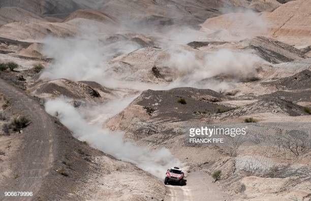 Mini's Finnish driver Mikko Hirvonen and German codriver Andreas Schulz compete during the 2018 Dakar Rally's Stage 12 between Chilecito and San Juan...