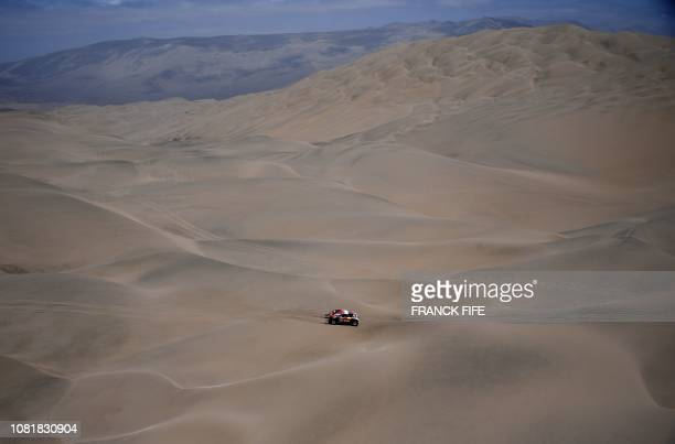Mini's French driver Stephane Peterhansel and co-driver David Castera compete during the Stage 6 of the Dakar Rally between Arequipa and San Juan de...