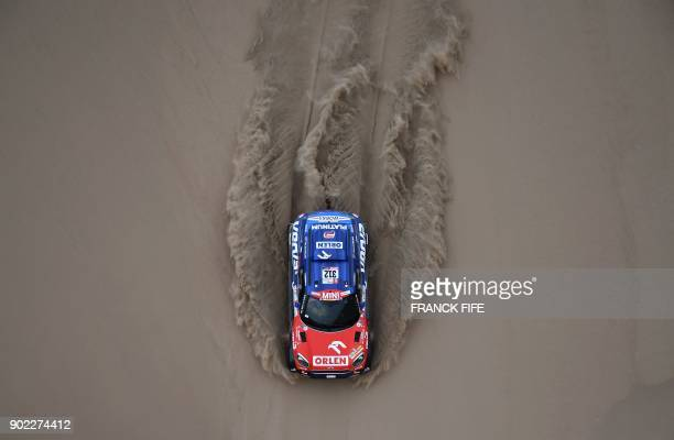 TOPSHOT Mini's Polish driver Jakub Przygonski and Belgian codriver Tom Colsoul compete during the 2018 Dakar Rally Stage 2 in and around the Peruvian...