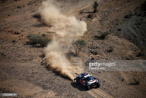 Mini's Spanish driver Carlos Sainz and co-driver Lucas Cruz compete during the prologue near the Saudi city of Jeddah, on the eve of the 2021 Dakar...