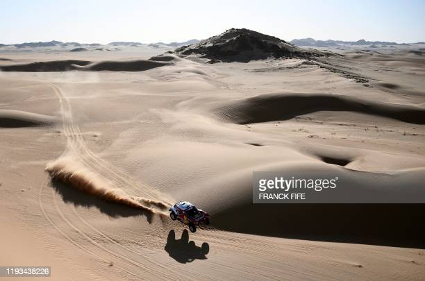 TOPSHOT Mini's Spanish driver Carlos Sainz of Spain and codriver Lucas Cruz of Spain compete in the Stage 8 of the Dakar 2020 around Wadi AdDawasir...