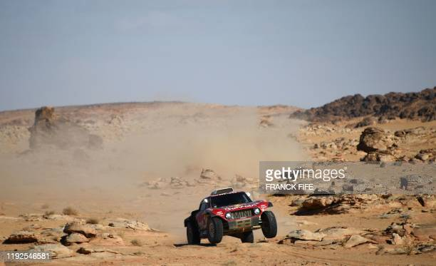 Mini's Spanish drivers Carlos Sainz and co-driver Lucas Cruz compete during the Stage 4 of the Dakar 2020 between Neom and Al-Ula, Saudi Arabia, on...