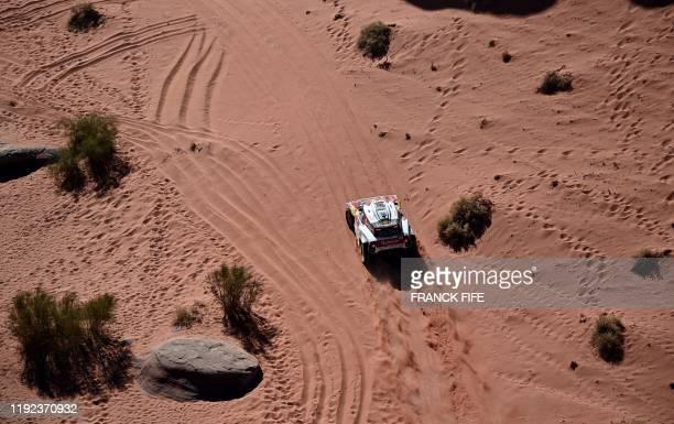 Mini's Spanish drivers Carlos Sainz of Spain and codriver Lucas Cruz compete during the Stage 3 of the Dakar 2020 around Neom Saudi Arabia on January...