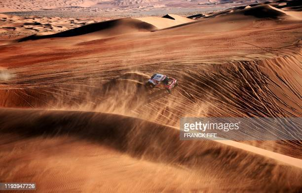 Mini's Spanish drivers Carlos Sainz of Spain and co-driver Lucas Cruz of Spain compete during the Stage 11 of the Dakar 2020 between Shubaytah and...