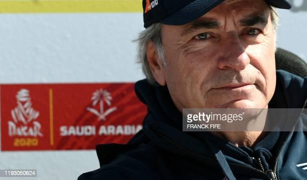 Mini's Spanish drivers Carlos Sainz of Spain looks on during the rest day of the Dakar 2020 between Ha'il and Riyadh, Saudi Arabia, on January 11,...