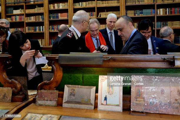 Minister Alberto Bonisoli and Commander Giovanni Nistri during the restitution ceremony of 594 ex voto paintings unlawfully removed from the Mexican...