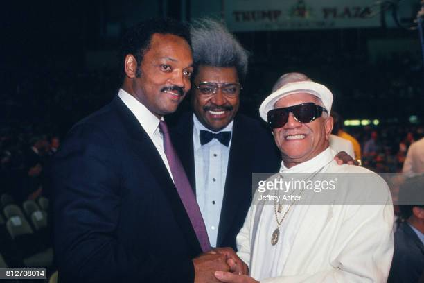 Minister And Politician Jesse Jackson with Promoter Don King and Comedian Redd Foxx at Tyson vs Holmes Convention Hall in Atlantic City New Jersey...