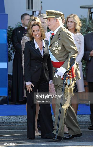 Minister Carme Chacon and King Juan Carlos of Spain attend The National Day Military Parade on October 12 2011 in Madrid Spain