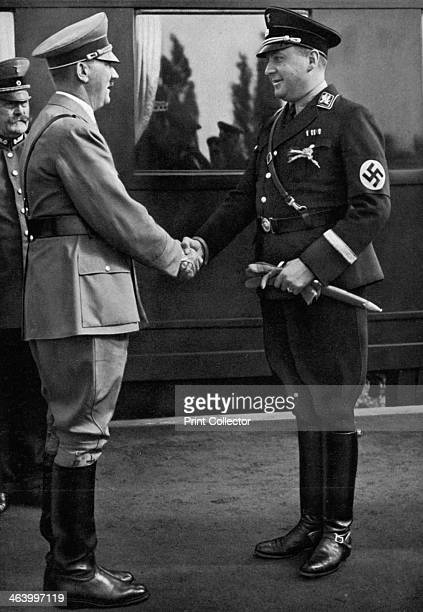 Minister Darré greets the Führer during Erntedankfestes 1936 Richard Walther Darré was an SSObergruppenführer and German Minister of Food and...
