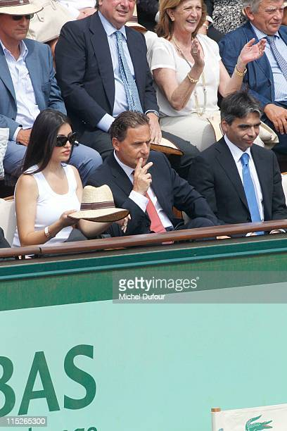 Minister Eric Besson and wife attend the French Open at Roland Garros on June 5 2011 in Paris France
