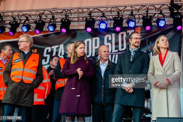 Minister Eric Wiebes the State Secretaries Stientje van Veldhoven Raymond Knops and Carola Schouten organiser Klaas Kooiker seen on stage during the...