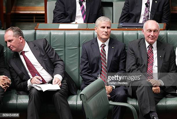 Minister for Agriculture and Water Resources Barnaby Joyce Michael McCormack and Deputy Prime Minister Warren Truss listen to Prime Minister Malcolm...