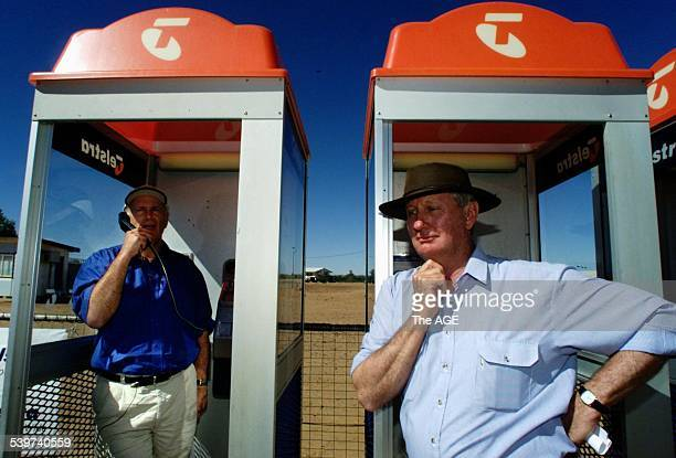 Minister for Communication, Senator Richard Alston in makes an untimed local call at a phone booth in Birdsville, Queensland, to Senator Ron Boswell...