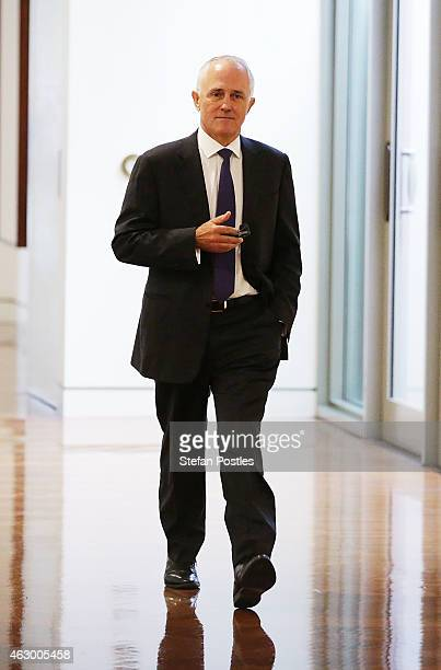 Minister for Communications Malcolm Turnbull walks to the party room at Parliament House on February 9 2015 in Canberra Australia Liberal party...