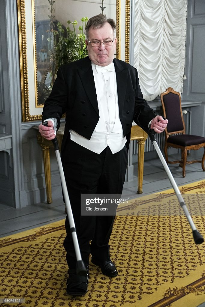 Minister for Defence Claus Hjort Frederiksen arrives to Queen Margrethe of Denmark's New Year's reception at Amalienborg on January 1, 2017 in Copenhagen, Denmark. The Minister have recently had a little accident and shows his crutches.