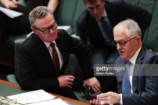 Minister for Defence Industry Christopher Pyne speaks with Prime Minister Malcolm Turnbull during House of Representatives question time at...