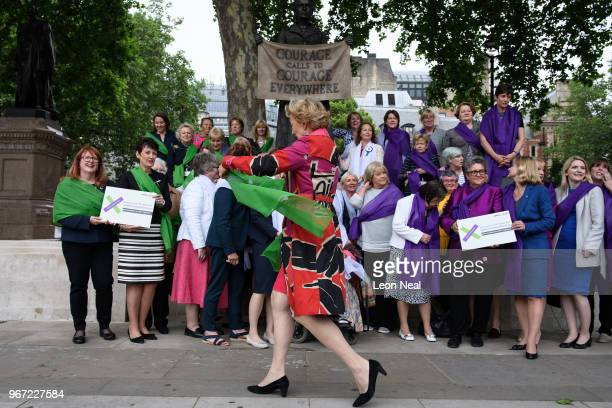Minister for Energy and Climate Change Andrea Leadsom arrives before posing with other female MPs to promote the Processions march during a photocall...