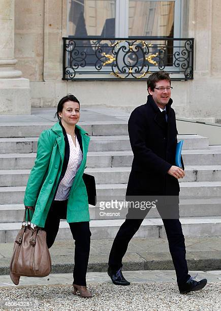 Minister for Equality of Territories and Housing Cecile Duflot and Junior Minister for Foreign Countries and Development Pascal Canfin leave after...