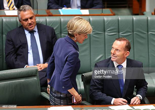 Minister for Foreign Affairs Julie Bishop speaks with Prime Minister Tony Abbott during House of Representatives question time at Parliament House on...
