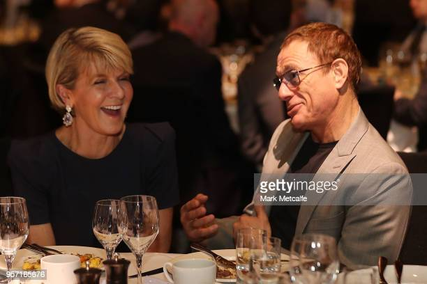 Minister for Foreign Affairs Julie Bishop talks to actor JeanClaude Van Damme before Prime Minister Malcolm Turnbull addresses guests at the NSW...