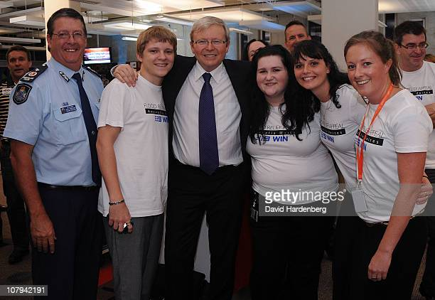 Minister for Foreign Affairs Kevin Rudd poses with flood Relief volunteers at the Channel Nine And Daily Telegraph telethon appeal for Queensland...