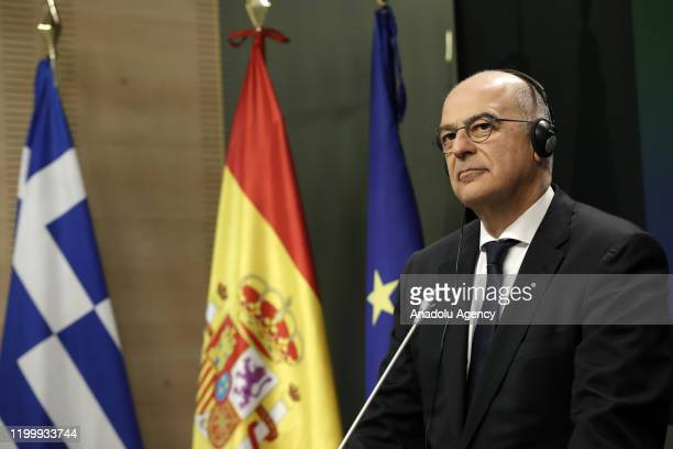 Minister for Foreign Affairs of Greece Nikos Dendias listens during a joint press conference with Minister of Foreign Affairs of Spain Arancha...